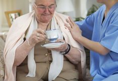 Non-medical care for elderly people. Nurse taking care of old women at home Royalty Free Stock Photos