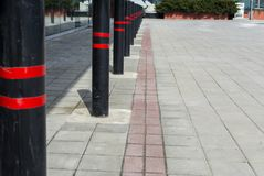 Non Parking space, red-black stripes pole. Security pole stock photo