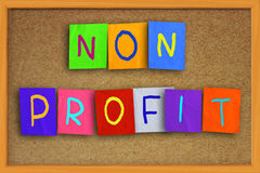 Non Profit Concept. The words Non Profit written on sticky colored paper over cork board Royalty Free Stock Images