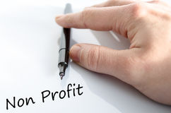 Non Profit. Human hand writing Non Profit over white background - business concept stock photos