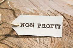 Non profit. Word written on a Looking card royalty free stock photos