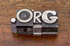 Non-profit organization internet domain. Dot org in mixed vintage metal type printing blocks over grunge wood stock images