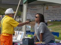 Non-Profit Participant Interviewed during the Rubber Duck Festival. Non-profit business sponsors have the opportunity to share about their booth at the 16th stock images