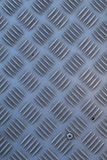 Non-slip industrial steel metal flooring, shot from above, flat lighting. Stock Photos