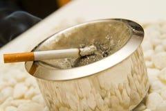 Non smoking. Burning cigarette smoking on ashtray Stock Photography