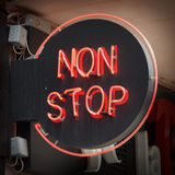 Non Stop. Red NON STOP neon sign Royalty Free Stock Photo