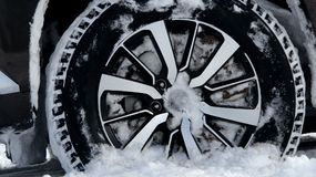 Non studded winter tire in the deep snow detailed Stock Photos