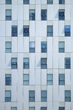 Non symmetric abstract background. Building facade. Non symmetric abstract background. A building facade with some open and closed windows Stock Photo