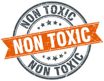 Non toxic round grunge stamp Royalty Free Stock Photography