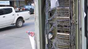 Non-working Electric Switchboard with Protruding Network and Telephone wires on the asia street. PATTAYA, THAILAND, DECEMBER 16, 2017: Non-working electric stock video