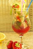 Nonalcoholic Cocktail. Nonalcoholic freshening drink with mint, strawberry and ice Royalty Free Stock Images