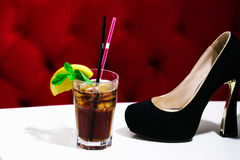 Nonalcoholic cocktail with shoe Royalty Free Stock Photography