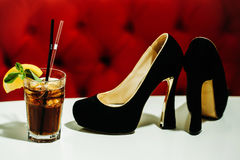 Nonalcoholic cocktail with shoes Stock Photography