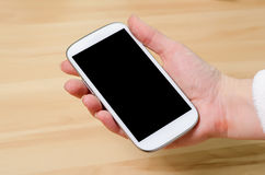 Noname Cellphone In Hand Royalty Free Stock Image