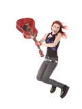Nonconformist girl. Jumps with a guitar Stock Photo