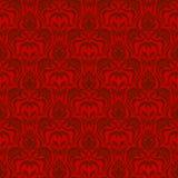 红色无缝的墙纸 免版税图库摄影
