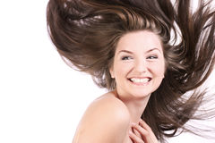 美丽的吹的头发妇女 免版税库存照片