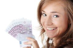 愉快的藏品货币妇女年轻人 免版税库存照片