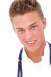医生微笑的年轻人 免版税图库摄影