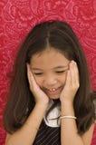亚裔表达式女孩惊奇了 免版税库存照片
