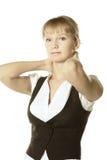 在白肤金发的女实业家之后递脖子 免版税图库摄影