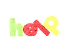 五颜六色的帮助信函 图库摄影