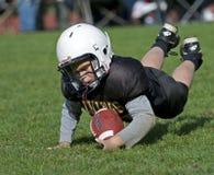 美国覆盖范围橄榄球青年时期 免版税库存图片