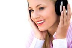 佩带妇女的耳机 免版税图库摄影