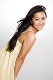 亚裔美丽的愉快的妇女 免版税库存照片