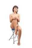 女孩裸体坐的凳子 免版税库存照片