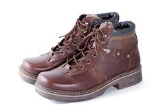 查出的对穿上鞋子冬天 图库摄影