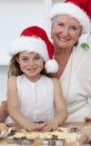 女孩祖母微笑的一点 库存照片