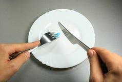 Голубая еда пилюльки Стоковое Изображение