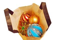 与圣诞节地球的袋子 免版税图库摄影
