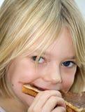 吃女孩年轻人 库存图片
