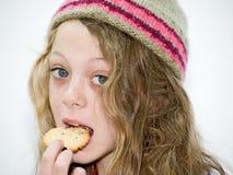 吃女孩年轻人 免版税库存图片