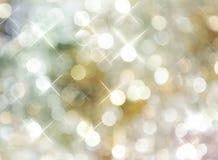 背景明亮的小点金黄银 库存照片