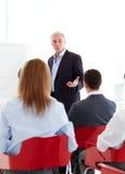 产生前辈的生意人会议 图库摄影