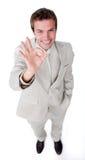 Ассерторический бизнесмен показывая ОДОБРЕННЫЙ знак Стоковые Изображения