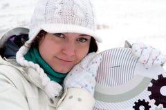 女孩挡雪板 免版税图库摄影