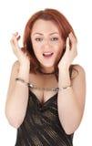 美丽的红色女孩头发的手铐 免版税图库摄影
