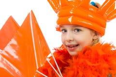 女孩橙色成套装备摆在 免版税库存照片