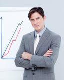 диаграммы бизнесмена уверенно сообщая сбывания Стоковые Изображения RF