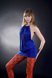背景黑色蓝色礼服惊人的妇女 免版税库存照片
