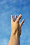 伸手可及的距离天空 免版税库存图片