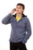美丽的少年联系在电话 免版税库存照片