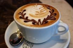 热奶咖啡杯子 免版税库存照片