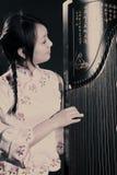 китайская цитра музыканта Стоковая Фотография