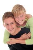 夫妇愉快的拥抱的年轻人 免版税库存照片