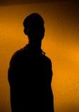 задним освещенный руководителем силуэт человека Стоковое Изображение RF